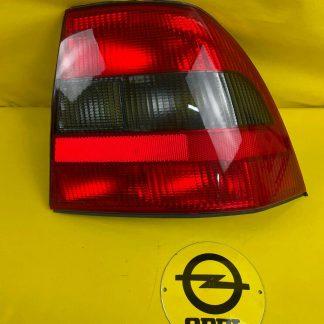 NEU + ORIGINAL GM / Opel Vectra B Rücklicht rechts getönt